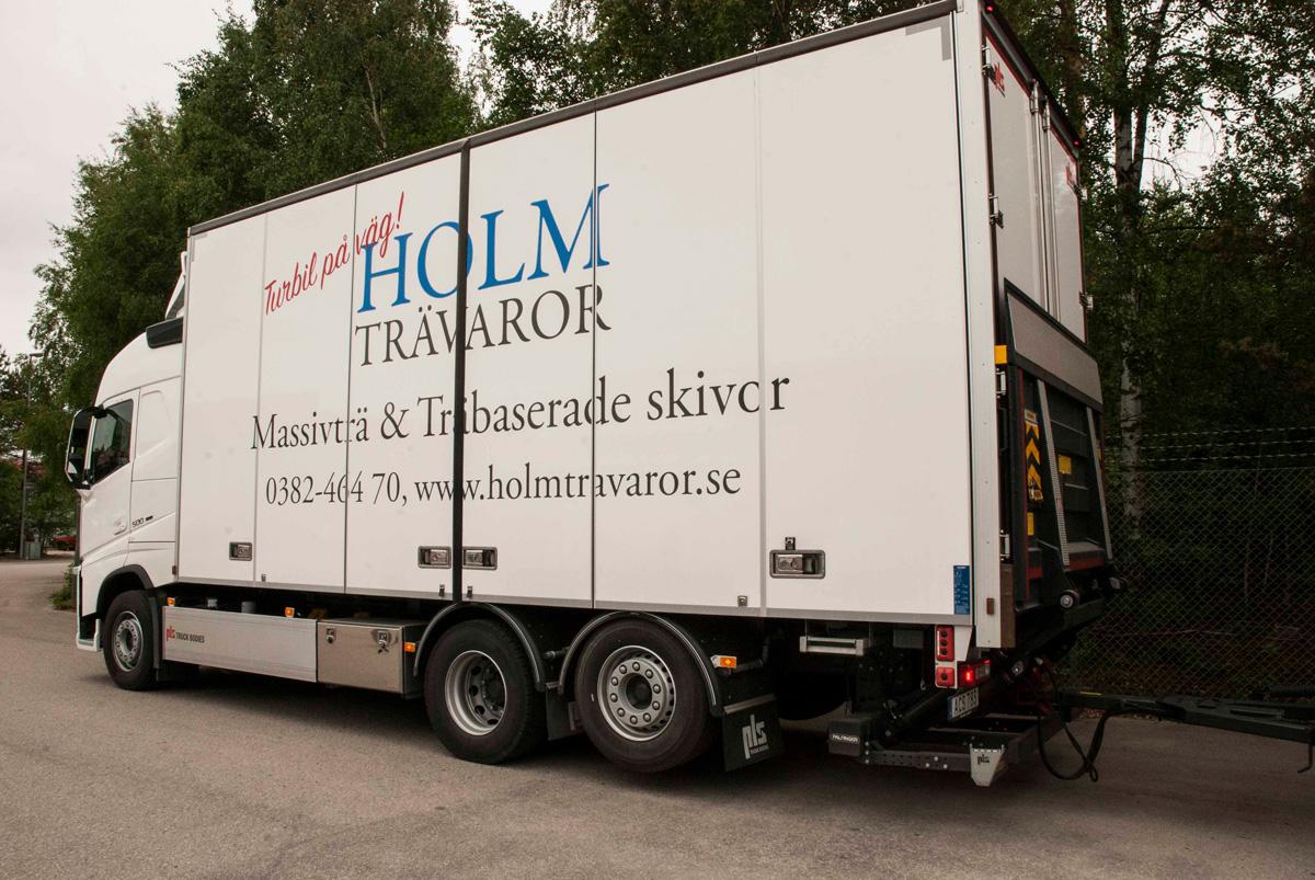Holm Trävaror lastbilsdekor utan släp sida